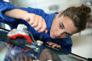 auto glass specialist performing windshield chip repair